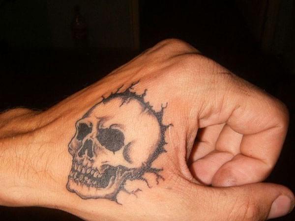 skull hand tattoo men