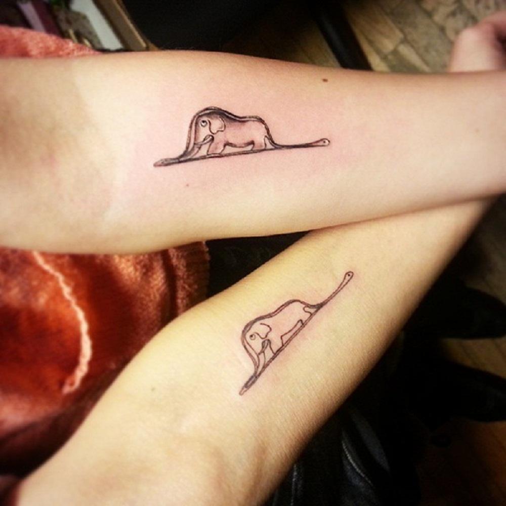 book tattoo forearm