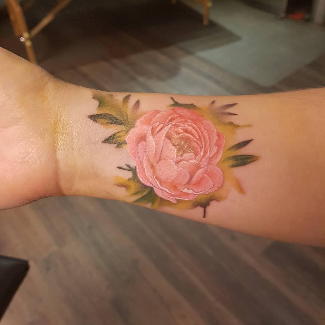 wrist peony tattoo
