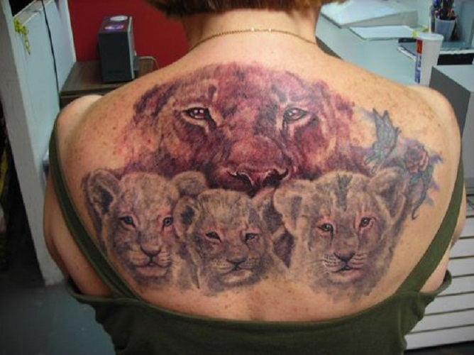 mother daughter tattoos lion and cub
