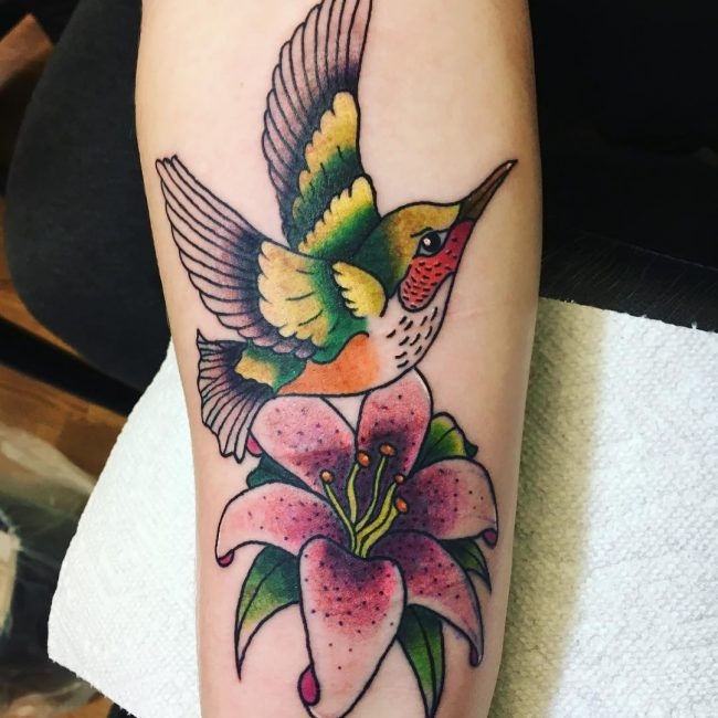 hummingbird tattoo with flowers