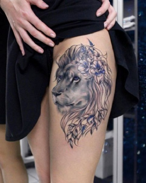 lion tattoo thigh