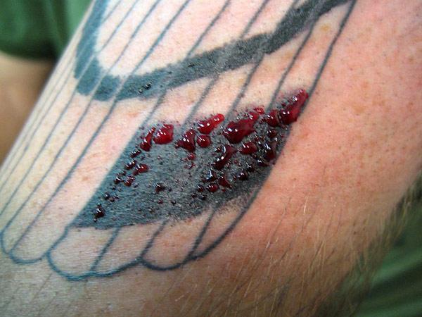 blood on tattoo