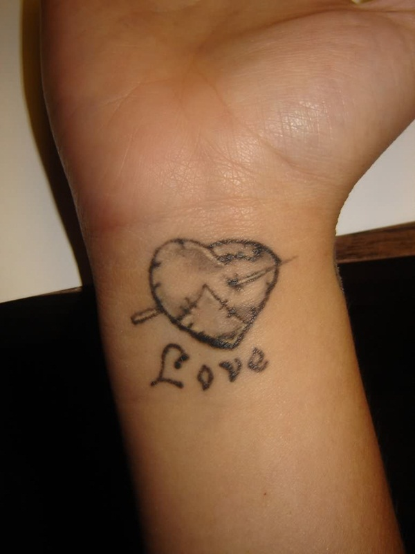 stitched heart tattoo