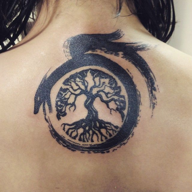 circle ouroboros tattoo 8