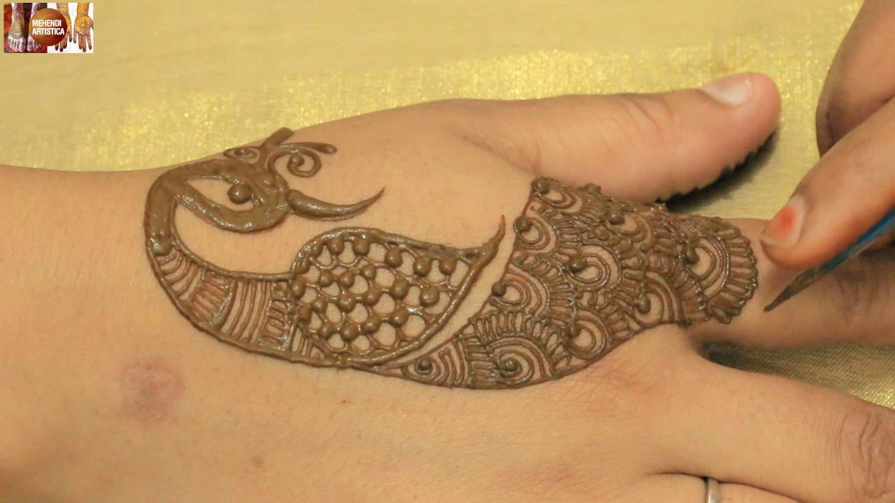 peacock hand henna tattoo