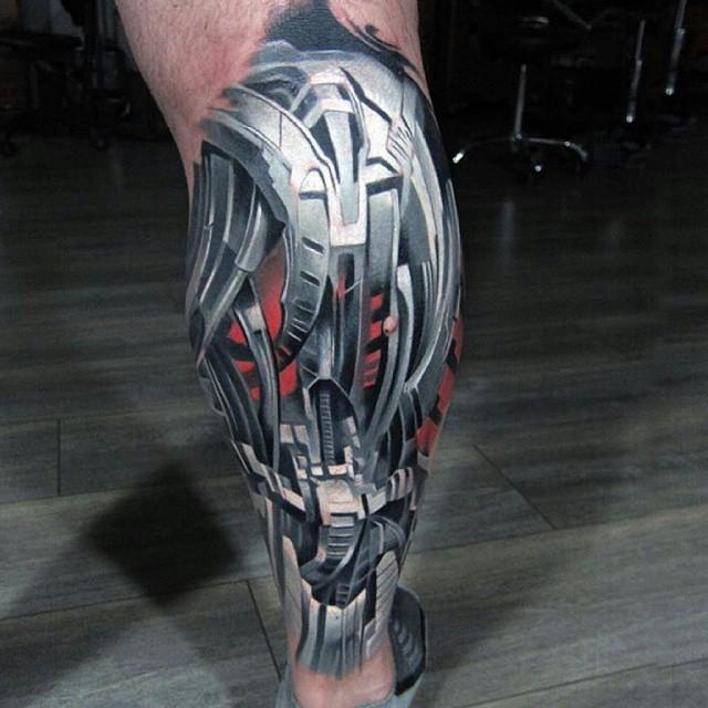 Robo-Armor-Biomechanical-Tattoo-on-Leg-by-Piotr-Dedel.jpg