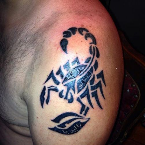 inner-forearm-tattoo-of-tribal-scorpion-on-man