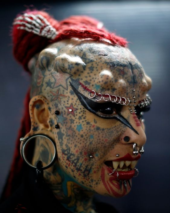 extreme tattoos and eyebrow piercings