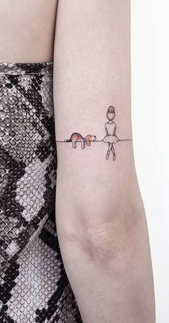 Cute dog and lady tattoo on the arm