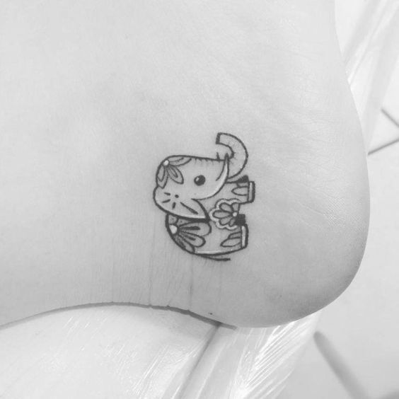 Cute elephant tattoo on the ankle