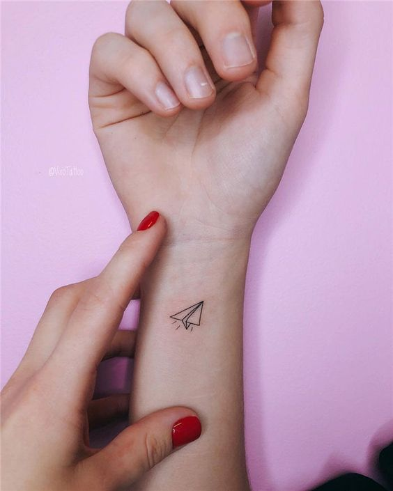 Paperplane tattoo on the wrist