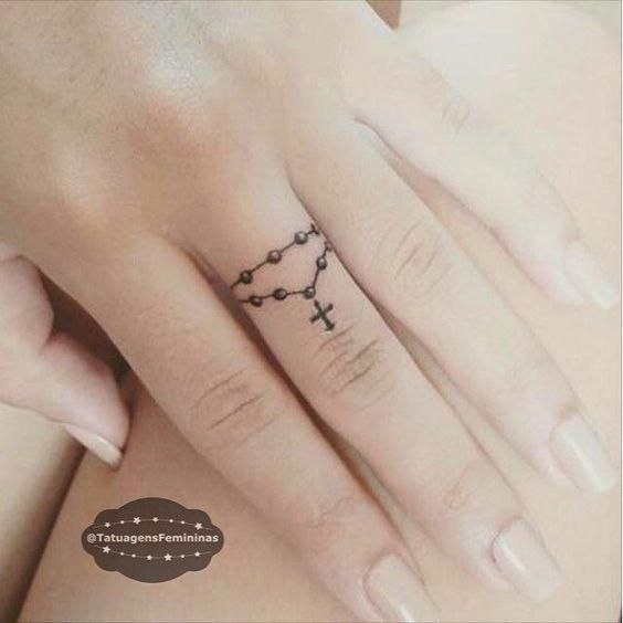 Rosary tattoo on the finger