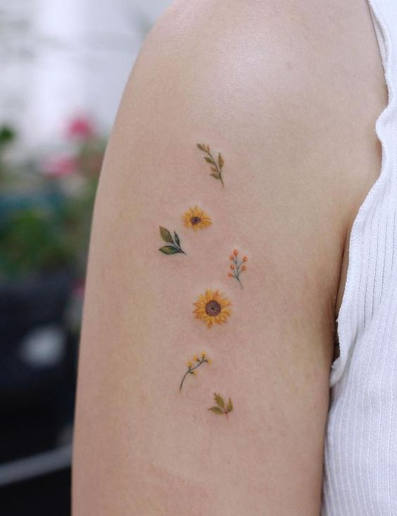 Sunflower tattoo on the arm