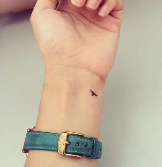 Tiny bird tattoo on the wrist